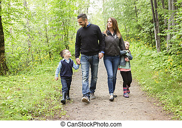 family in forest on a meadow