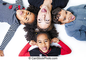 A family lay on the floor of a photography studio