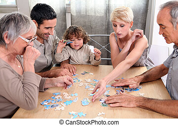 a family making a puzzle