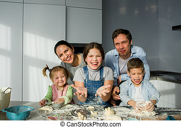 A family of five in the kitchen