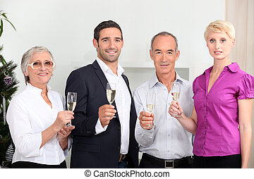 a family toasting with sparkling wine