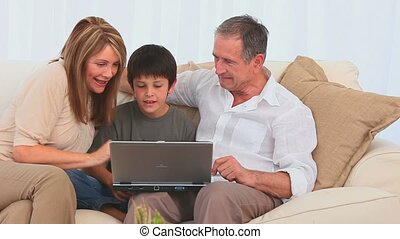 A family using a laptop together