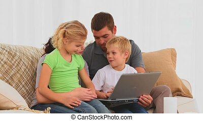 A family using a laptop
