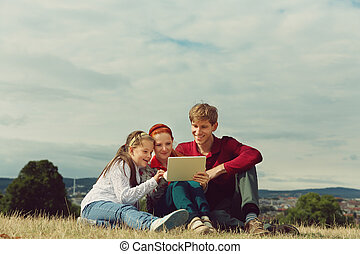 family using a tablet computer
