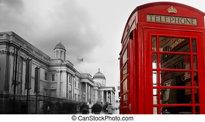 a famous london phone box, with people rushing by, trafalgar...