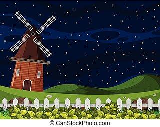 A farm landscape at night