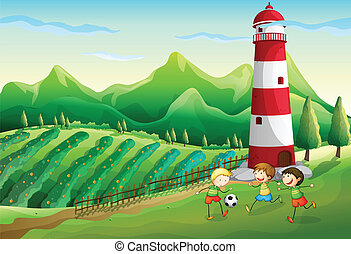 A farm with children playing near the tower