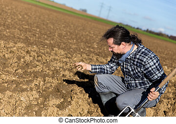 Farmer controlling the ground of his field