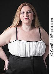 A fashion woman in studio black background