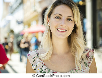 Fashion woman portrait of young pretty trendy girl posing on the quebec city street