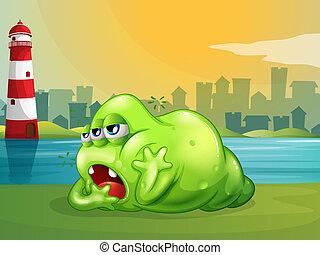A fat green monster across the lighthouse