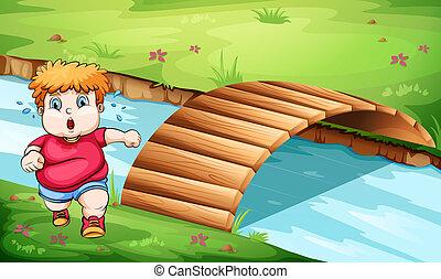 A fat man jogging near the bridge