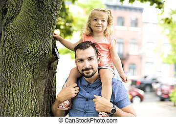 Father and Daughter in a park on summer day