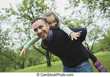 Father and daughter in forest on a meadow