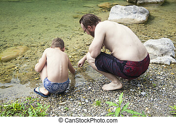 A father and son having fun at the river