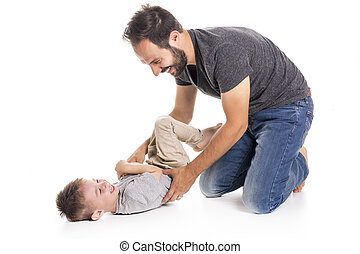 Father and son having fun over white background