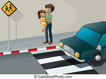 A father carrying his daughter at the pedestrian lane