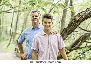 Father having fun in forest with his son