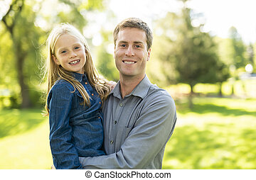A father with daughter in summer park