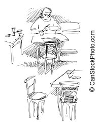 a fellow has dinner at the table in a cafe