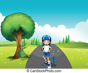 A female biker standing in the middle of the street