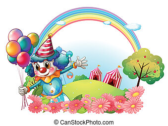 A female clown at the hill with a rainbow