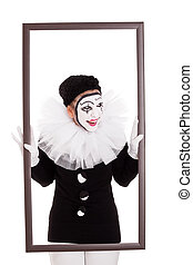 a female clown in a frame is looking angry - female clown in...