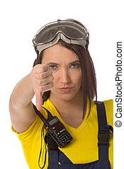 A female construction worker holding a down signal - isolated.