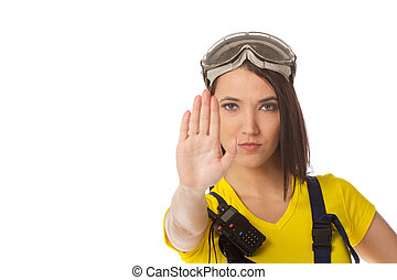 A female construction worker holding a stop signal - isolated.