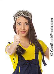 A female construction worker holding an ok signal - isolated.