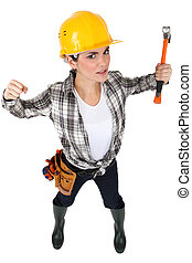 A female construction worker in a fighting stance.
