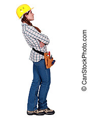 A female construction worker looking away.