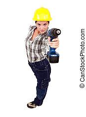 A female construction worker using a drill as a gun.