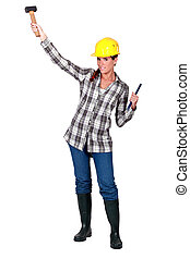 A female construction worker with a hammer.