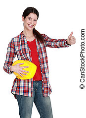 A female construction worker with the thumb up.