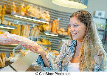a female customer in bakery