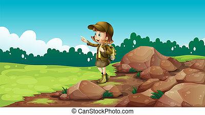 A female explorer near the rocks - Illustration of a female...