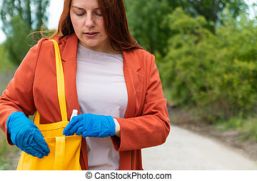 A female hand in medical disposable gloves lays an ...