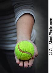 A female holding tennis ball