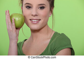 A female model with an apple.