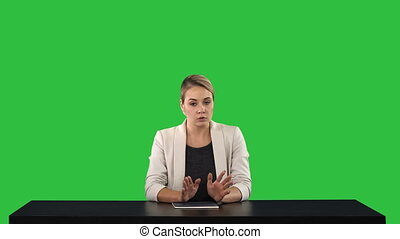 A female newsreader presenting the news, add your own text or image screen behind her on a Green Screen, Chroma Key.