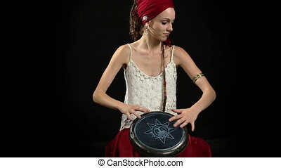 a female percussion drummer performing with bongos,...