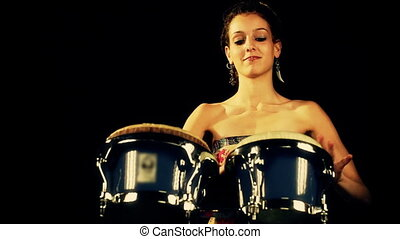 a female percussion drummer performing with bongos
