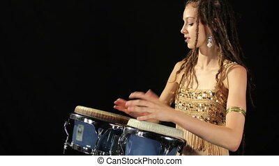 a female percussion drummer performing with bongos, shot as a sequence of still images