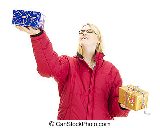 A female person juggling with two colorful gifts