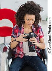 a female photographer in wheelchair