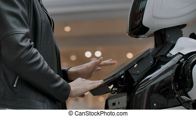 A female programmer tests the robot for the ability to...
