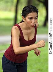 A female runner in the park