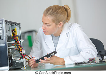 a female worker checking the hard drive