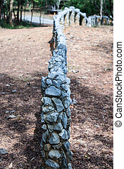 A fence made of rocks, Selective focus
